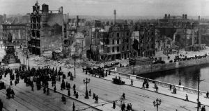 A v iew of Sackville Street (O'Connell St) and the River Liffey at Eden Quay in Dublin, on May  11th, 1916 showing the devastation wrought during the Easter Rising