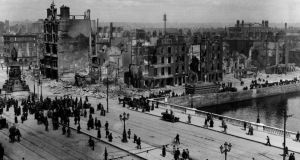 A view of Sackville Street (O'Connell St) and the River Liffey at Eden Quay in Dublin, showing the devastation wrought during the Easter Rising.