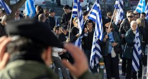 Far-right party: Golden Dawn supporters holding Greek flags during a rally outside a courthouse in Athens, Greece. Photograph: Simela Pantzartzi/EPA