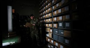 Cmdt Padraic Kennedy studies files in the reading room at Cathal Brugha Barracks in Dublin.  Photograph:  Brian Lawless/PA