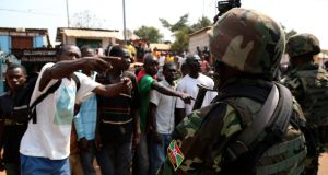 Angry men point at African Union  soldiers in Gobongo district in the Central African Republic capital Bangui yesterday.  More than 1,000 people were killed last month alone in  Bangui. Photograph: Emmanuel Braun/Reuters