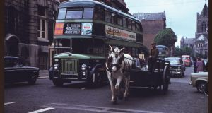 A one-horse dray beside a Dublin city bus in Dame Street. Photograph: Charles Cushman: From the University of Indiana Collection .