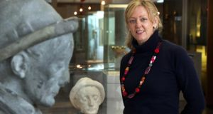 Director Eithne Verling in Galway City Museum, beside the statue of Pádraic Ó Conaire that had its head removed by vandals before being repaired. Photograph: Joe O'Shaughnessy