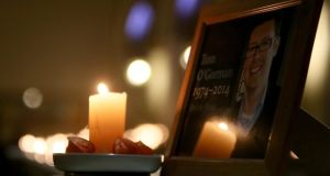 A photograph of Tom O'Gorman, who was found dead at his home in Castleknock, is displayed at a prayer vigil held for him at St Teresa's, Clarendon St, Dublin. Photograph: Brian Lawless/PA