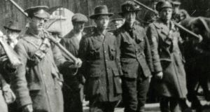 Michael Mallin, who was executed, and Countess Markievicz being escorted away by government troops. Photograph: Courtesy of National Museum of Ireland