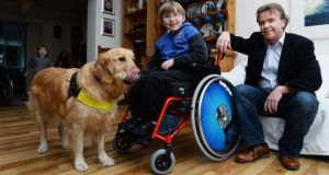 Tom Clonan with his son Eoghan (11) and Duke, Eoghan's assistance dog, at home in Booterstown, south Dublin. Photograph: Cyril Byrne/The Irish Times