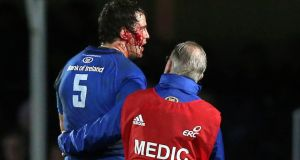 Leinster's Mike McCarthy  leaves the field with a blood injury after Ian Evans was sent off. Photograph: Donall Farmer/Inpho