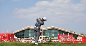 Rory McIlroy plays his approach on the ninth hole during the third round. Photograph: Ahmed Jadallah/Reuters