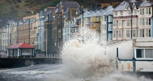 The promenade wall in Aberystwyth,  Wales, takes a battering from waves driven by storm-force winds earlier this month. Photograph: Dimitris Legakis/EPA