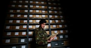 Officer in charge of military archives Commandant Padraic Kennedy studies files in the reading room at Cathal Brugha Barracks in Dublin. Photograph: Brian Lawless/PA Wire