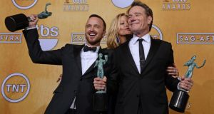 Breaking Bad actors Bryan Cranston (R), Anna Gunn (C) and Aaron Paul (L) hold awards at the 20th Annual Screen Actors Guild Awards. Photograph: Paul Buck/EPA