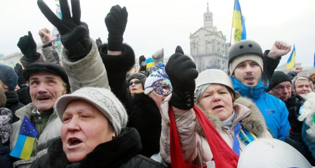 Pro-European protesters shout slogans and make hand gestures during a rally on Independence Square in Kiev. Photograph: Gleb Garanich /Reuters
