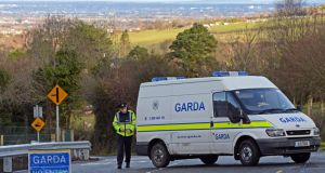 A garda road-block at the scene , where the remains of a man believed to be in his 30s have been found with gunshot wounds, at Bohernabreeena road, Tallaght, Co Dublin. Photograph: Eric Luke / The Irish Times