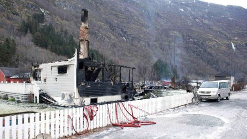 The burnt out remains of a building is pictured after a fire in Laerdal, western Norway. Police have launched a large-scale evacuation across a historic wood village after a fire began overnight at a house and spread rapidly.  Photograph: Marit Hommedal/NTB Scanpix/Reuters