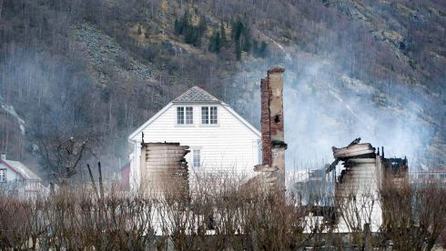 The burnt out remains of a building is pictured after a fire in Laerdal, western Norway. At least 90 people were hospitalised. Photograph: Marit Hommedal/NTB Scanpix/Reuters