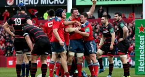 Munster's Peter O'Mahony punches the air after scoring his side's fourth try against Edinburgh at Thomond Park. Photograph: James Crombie/Inpho