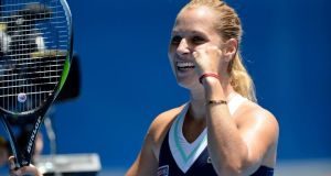 Slovakia's  Dominika Cibulkova  celebrates after she defeated Maria Sharapova in their fourth-round match at the Australian Open  in Melbourne. Photograph: Franck Robichon/EPA