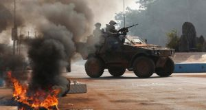 French troops secure an area after protesters set fires on a street in Bangui, Central African Republic, yesterday.  Photograph: Emmanuel Braun/Reuters