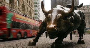 The Wall Street bull in New York: NYSE Technologies, the technology arm of NYSE Euronext first came to Belfast in 2009 to open its technology centre of excellence. Photograph: Spencer Platt/Getty