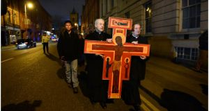 Archbishop Michael Jackson and Archbishop Diarmuid Martin carrying the Taize Cross down Dame Street, Dublin during the Good Friday procession last year. Photograph: Brenda Fitzsimons