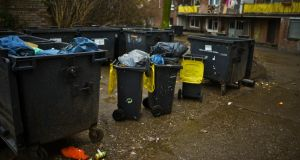 Overflowing bins outside a Roma block in Duisburg. Photograph: Sascha Schuermann/Getty Images