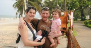 Roxana and Brian Hefferon in Thailand with their newborn daughter Mia and one-year-old Sophie.