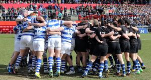 Rockwell and Crescent teams don't give an inch before last year's Munster Senior Cup final at Thomond Park, Limerick. Photograph: Inpho