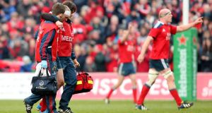 Munster's Keith Earls leaves the field injured against Edinburgh on Sunday. Photograph: James Crombie/Inpho