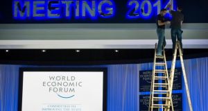 Workers make the last preparations inside the Congress Center, two days before the opening of the 44th Annual Meeting of the World Economic Forum in Davos, Switzerland. Photograph: Jean-Christophe Bott/EPA