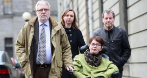 A file image showing Marie Fleming with her partner Tom Curran (left), daughter Corrinna Moore, and family friend Brendan Gainey outside the High Court last year after she lost her case challenging the absolute ban on assisted suicide. Photograph: Alan Betson/ The Irish Times