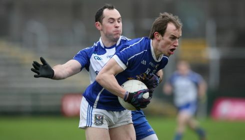 McKenna Cup semi-final: In Brewster Park,  Cavan saw off Monaghan 0-16 to 1-9.  Cavan's Martin Reilly holds off Stephen Galloghy in this piece of action. Photograph: Andrew Paton.