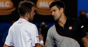 Stanislas Wawrinka of Switzerland shakes hands with Novak Djokovic (right) of Serbia  after winning their men's singles quarter-final   at the Australian Open. Photograph: Bobby Yip/Reuters