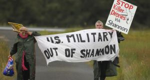 File photo dated October 7th, 2012 of Shannon Peace activists Niall Farrell (right) and Margaretta D'arcy attempting to block the runway of Shannon Airport in protest at the use of the airport by the CIA and US Military  Photograph: Niall Carson/PA