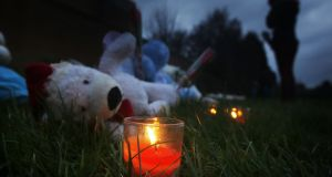 Candles and tributes left in Ferry Gait Crescent in Edinburgh, Scotland, near to the home of missing three-year-old Mikaeel Kular,  as his mother has reportedly been detained by police after a child's body was discovered in Kirkcaldy, Fife. Photograph: Danny Lawson/PA Wire