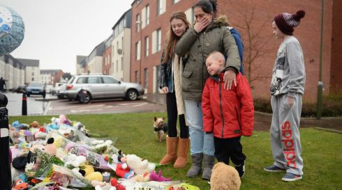 Members of the public lay tributes in Ferry Gate Crescent near the home of three- year-old Mikaeel Kular. Photograph: Jeff J Mitchell/Getty Images