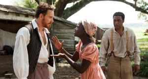 Michael Fassbender,  Lupita Nyong'o and Chiwetel Ejiofor in a scene from 12 Years A Slave. Photograph: AP Photo/Fox Searchlight, François Duhamel