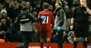 Liverpool's Lucas leaves the pitch after he was injured during the  match against Aston Villa. Photograph: Phil Noble/Reuters
