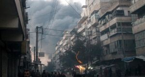 Smoke rises from a site hit by what activists say are barrel bombs dropped by government forces on al-Katerji district in Aleppo yesterday. Photograph: Reuters