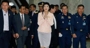 Thailand's Prime Minister Yingluck Shinawatra speaks to reporters following the declaration of a state of emergency in Bangkok yesterday. Photograph: Reuters