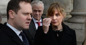 Roberta Dodd looks at her husband David as he reads a statement outside the High Court on Tuesday. Photograph: Dara Mac Dónaill/The Irish Times