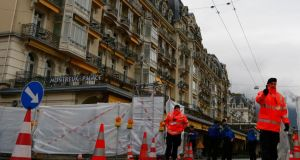 "Swiss police secure the area of the Montreux Palace hotel where the ""Geneva II"" international conference will take place today. Photograph:  Jamal Saidi/Reuters"