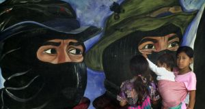 Faces of resistance: a mural of Zapatista rebels. Photograph: Susana Gonzalez/Newsmakers