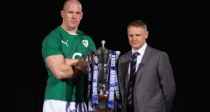 Ireland captain Paul O'Connell  and  coach Joe Schmidt pose with the Six Nations trophy at the Hurlingham club in London today.  Photograph: Bryn Lennon/Getty Images