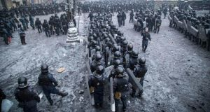 Riot police and interior ministry members stand in formation during clashes with pro-European protesters in Kiev yesterday. Photograph: Reuters/Stringer