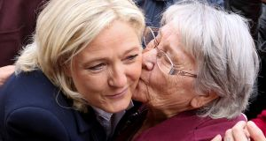 President of the French far-right Front National party Marine Le Pen (left) is kissed by a woman in Brachay in northeastern France. Photograph: Francois Nascimbeni/AFP/Getty Images