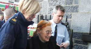 Margaretta D'Arcy being escorted into Ennis Court yesterday.