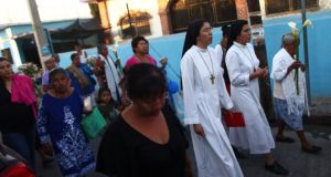 Nuns, friends and neighbours of inmate Edgar Tamayo walk during a procession, praying for him in Miacatlan, Morelos state yesterday. Photograph: Edgard Garrido/Reuters