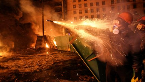 A pro-European integration protester fires off fireworks towards riot police during clashes in Kiev. Photograph: Valentyn Ogirenko /Reuters