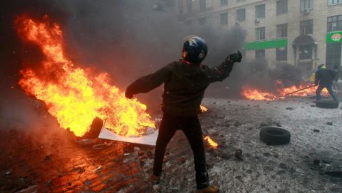 A pro-European protester throws a stone during clashes with riot policemen in Kiev. Photograph: Gleb Garanich/Reuters