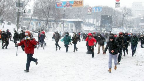 Protesters run away from riot police during an anti-government protest in downtown Kiev, Ukraine. Photograph: Zurab Kurtsikidze/EPA